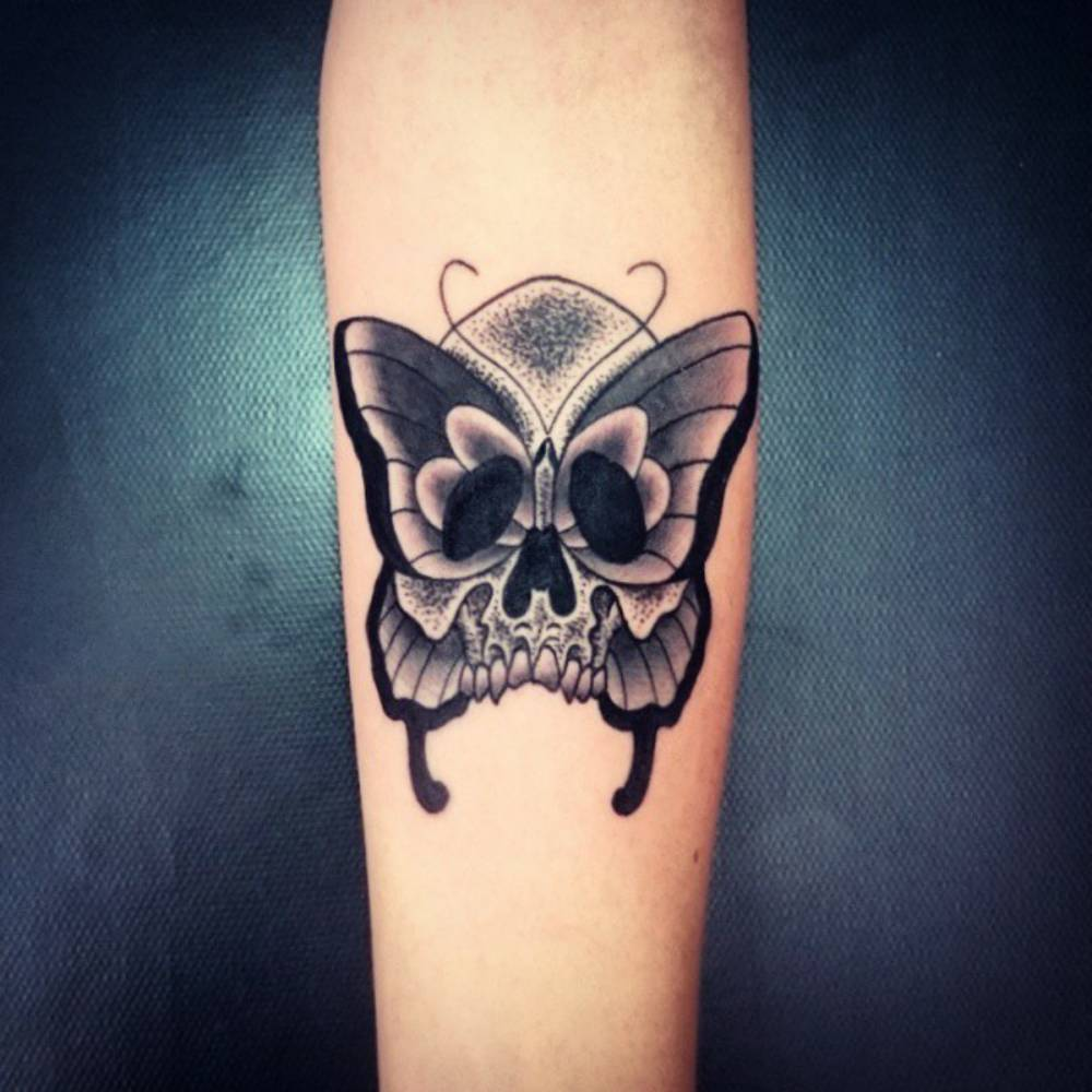 60 best butterfly tattoos meanings ideas and designs 2018 rh pacho tattoo com butterfly skull tattoo old school skull butterfly tattoo la ink