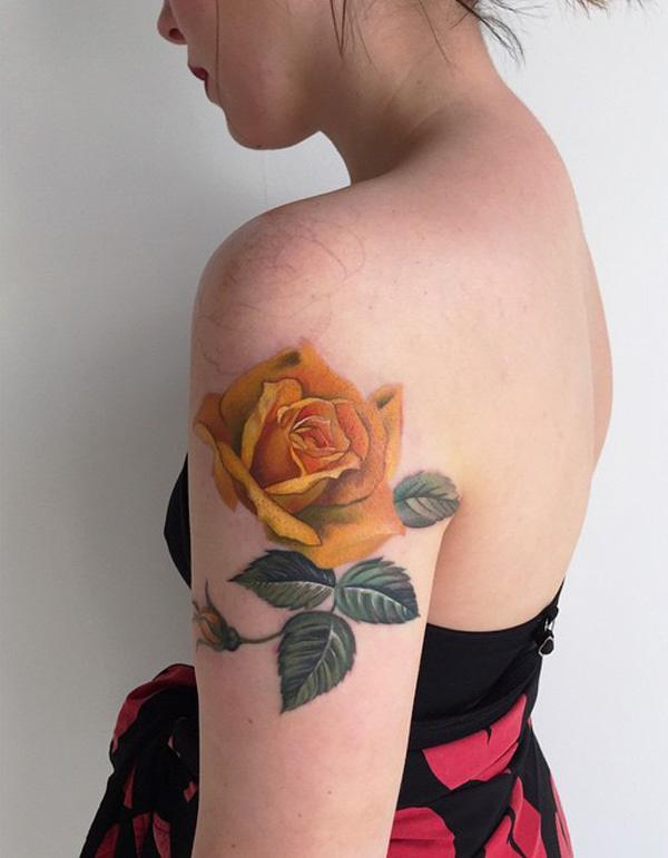 60 best flower tattoos meanings ideas and designs for 2016 for Yellow tattoo on dark skin