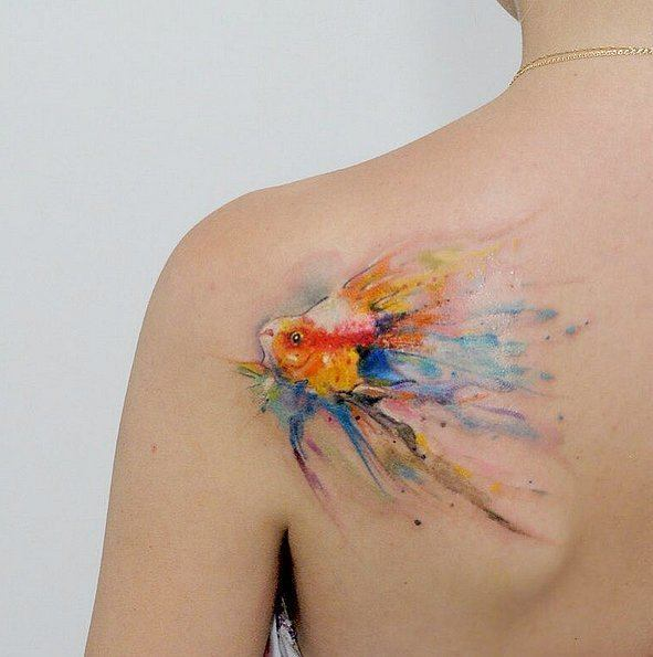 60 best watercolor tattoos meanings ideas and designs for Goldfish tattoo meaning